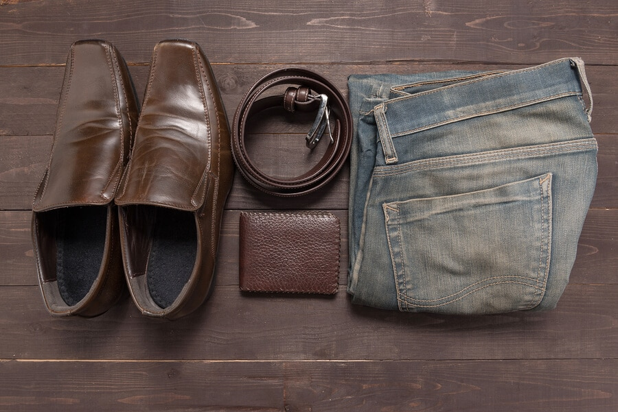 brown shoes and accessories with blue jeans
